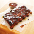 Bbq ribs shot with selective focus in square composition Royalty Free Stock Image