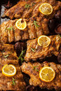 Bbq spare ribs with orange and dips Royalty Free Stock Image