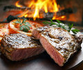 Bbq steak juicy with tomato Stock Images