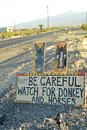 Be Careful of wild donkey and horses road sign along side highway Pahrump, Nevada, USA Royalty Free Stock Photo