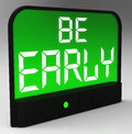 Be early alarm clock message shows deadline and on time Stock Photo