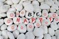 Be happy message over white stones Royalty Free Stock Photo