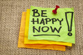Be happy now motivation advice handwriting on sticky notes Royalty Free Stock Images