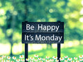 Be happy it s monday signpost in beautiful woodland with vintage filter Stock Image
