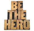 Be the hero in wood type isolated text letterpress Stock Image