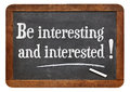 Be interesting and interested social media reminder concept white chalk text on a vintage slate blackboard Stock Photo