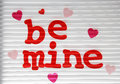 Be mine valentine stuck on a window sign with white blind background Royalty Free Stock Photos