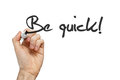 Be quick handwritten phrase on whiteboard Royalty Free Stock Photography