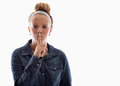 Be quiet young girl using her finger to say on white background Royalty Free Stock Images