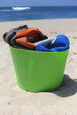 Be ready for surfing wetsuits in the bucket on the beach Royalty Free Stock Image