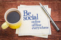 Be social online and offline everywhere handwriting on a napkin with a cup of coffee Stock Images