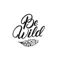 Be wild hand written lettering quote with feather.
