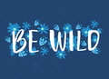 Be wild text with hand drawn flowers at blue background. Rough phrase for boho and hippie clothes, t-shirts, posters