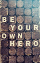 Be your own hero message message cross processed image for vintage look Royalty Free Stock Photography