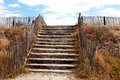 Beach access over protective dunes with stairs Royalty Free Stock Photos