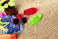 Beach accessories for baby toddler on sand Stock Photo