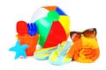 Beach accessories collection of towel ball flip flops sunglasses and toys Stock Photography