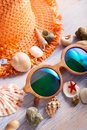 Beach accessories glasses hat cockleshells Royalty Free Stock Photo