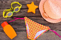 Beach accessories on the old wooden background toned image Stock Photos