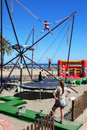 Beach activities bungee trampolines on the marbella costa del sol spain Stock Image