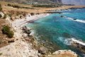 Beach along rocky seacoast overlooking a small the near san vito lo capo sicily Stock Photography