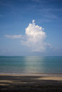 Beach background with cloudy blue sky Royalty Free Stock Photo
