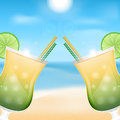 Beach background two glasses with cocktails on the of sea and sky summer Stock Images
