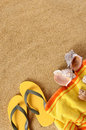 Summer beach background yellow towel copy space vertical Royalty Free Stock Photo