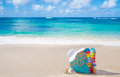 Beach bag with flip flops by the ocean decoration and woman s white hat Royalty Free Stock Photo