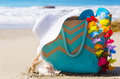Beach bag with flip flops by the ocean decoration and woman s white hat Royalty Free Stock Image