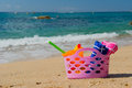 Beach bag pink in the sand near the water line at the spanish Royalty Free Stock Photo