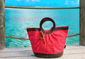 Beach bag and sun glasses on sea  background Royalty Free Stock Image