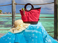 Beach bag and sun glasses on sea  background Royalty Free Stock Photography
