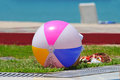 Beach ball colorful sitting by the edge of a pool Stock Images