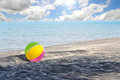 Beach ball at a desered with a beautiful blue sky in the pacific coast of panama Stock Photo