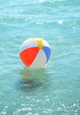 Beach ball floating in the ocean swimming pool summer vacation Royalty Free Stock Photography