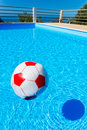 Beach ball floating on water in swimming pool Royalty Free Stock Photo