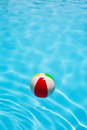 Beach ball in pool clear blue water vacation concept Stock Photo