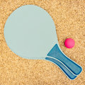 Beach ball set two rackets and on sandy background overhead view Stock Photo