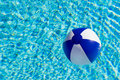 A colorful beach ball in swimming pool