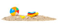 Beach ball towels and toys sand with shells Stock Photo