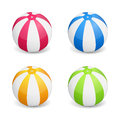 Beach balls colored on white background Stock Images