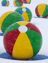 Beach Balls in Winter Snow Stock Photo