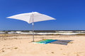 Beach of baltic sea in sobieszewo white parasol on the Royalty Free Stock Images