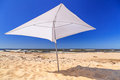 Beach of baltic sea in sobieszewo white parasol on the Royalty Free Stock Photos