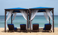 Beach beds covered sunbeds in barbados Royalty Free Stock Photography