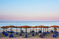 Beach beds and umbrellas lined up on thassos island Royalty Free Stock Image