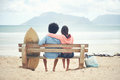 Beach bench couple Royalty Free Stock Photo