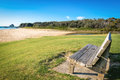 Beach bench solid timber with outlook to sea Stock Photo