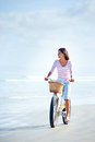 Beach bicycle woman carefree with riding on sand having fun and smiling Royalty Free Stock Photos